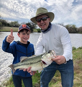 Doctor Faulconerand his son on a fishing trip