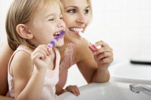 mother & daughter brushing
