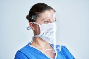 dentist in El Reno wearing a face shield